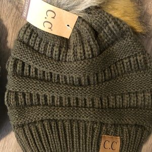 Olive c.c. Beanie with tan Pom on top